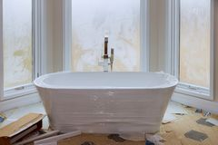 Master bath in new construction home with white tub. Master bath in bathroom in new luxury house new construction home with white tub stock image