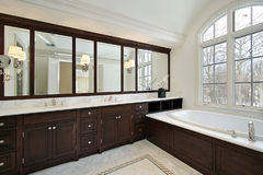 Master bath with dark cabinetry Stock Images
