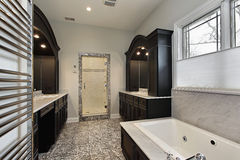 Master bath with dark cabinetry Royalty Free Stock Image