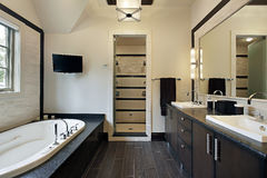 Master bath with dark wood cabinetry Royalty Free Stock Photos