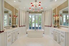Master bath with freestanding bathtub. Master bath in luxury home with freestanding bathtub royalty free stock photo