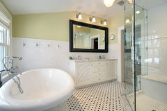 Master bath in luxury home. With glass shower and large tub Stock Photo