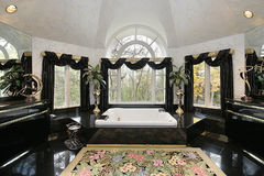 Master bath in luxury home. With curved window Royalty Free Stock Images