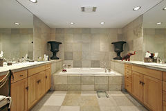 Master bath in luxury home. With stone walls and tub Royalty Free Stock Image