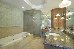 Master bath in luxury home. With glass shower Royalty Free Stock Images