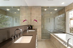 Master bath in luxury home. Master bath in modern home with glass shower Stock Photos
