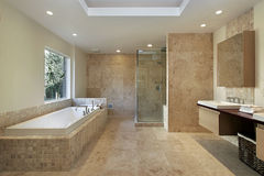 Master bath in new construction home. Modern master bath with marble walls and glass shower Stock Photos
