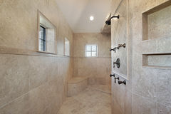 Master bath in new construction home. Large open air master bath shower with windows Stock Photography