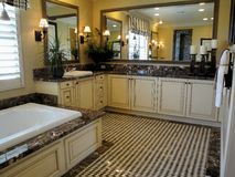 Master Bath Room. Beautiful master bath room with a spa tub granite counter tile floors Stock Image