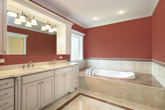 Master bath with salmon colored walls Royalty Free Stock Photo