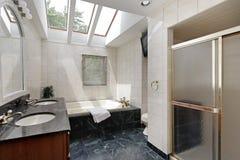 Master bath with skylights. Master bath in suburban home with skylights above bathtub Stock Photo