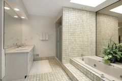 Master bath with step up tile tub Stock Photography