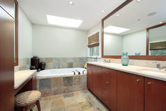 Master bath with stone bathtub Royalty Free Stock Photos