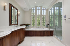 Master bath with wood cabinetry Stock Image