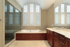 Master bath with wood paneled tub Stock Photo