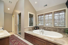 Master bath with wood paneled tub Stock Images