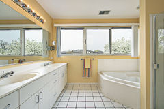 Master bath with yellow walls Stock Photo