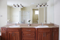 Master bathroom. Luxurious masterbath with jack and jill sinks and a huge mirror Stock Photography