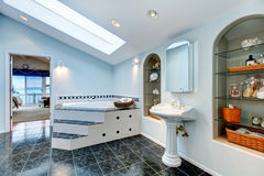 Master bathroom with blue marble tile floor and corner bath tub. Royalty Free Stock Image