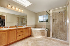Master bathroom with corner bathtub and tile floor Stock Photos