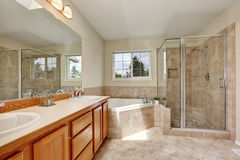 Master bathroom with corner bathtub and tile floor Royalty Free Stock Photography