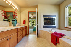 Master bathroom with fireplace, large vanity cabinet Stock Photos
