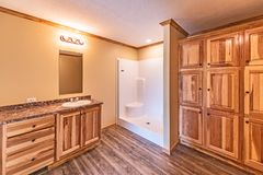Master Bathroom in Manufactured Home. Large master bathroon in a newly delivered manufactured home.  Too bad the flooring isn`t the one that was ordered stock images