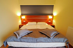 Master bed. A comfortable double bed in a modern hotel room Stock Images