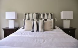 Master bedroom. A photo of a modern master bedroom stock photos