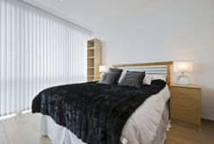 Master bedroom. Massive master bedroom with modern furniture and accessory royalty free stock photos