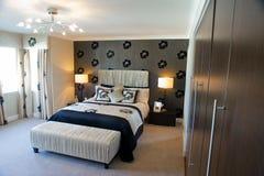 Master bedroom. Interior of a modern master bedroom Royalty Free Stock Photos