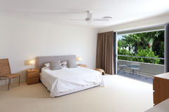 Master bedroom. Large master bedroom with king size bed and balcony Stock Images