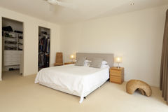 Master bedroom. Stylish master bedroom with ensuite Stock Images
