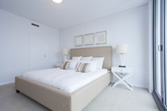 Master bedroom. Stylish master bedroom in new Australian appartment Royalty Free Stock Images