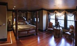 Master bedroom. Exclusive master bedroom with wood floor Royalty Free Stock Image