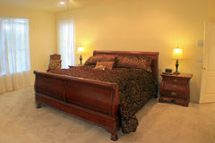 Master Bedroom. A Master Bedroom with a sleigh bed Royalty Free Stock Image