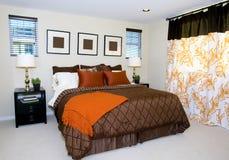 Master bedroom. Elegant contemporary master bedroom in earth tones stock image