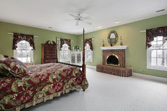 Master bedroom with brick fireplace Royalty Free Stock Photo