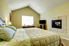 Master bedroom with built in fireplace and vaulted ceiling. stock photography