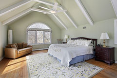 Master bedroom with ceiling beams stock image