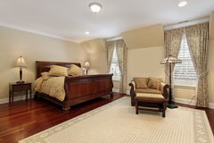 Master bedroom with cherry wood flooring stock images