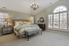 Master bedroom with circular window Stock Photos