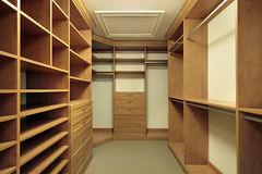 Master bedroom closet. Large master bedroom closet with wood paneling Royalty Free Stock Photo