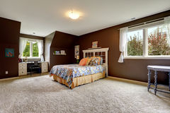 Master bedroom in dark brown color with office area Royalty Free Stock Photography