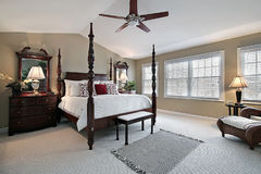 Master bedroom with dark wood furniture Royalty Free Stock Photos