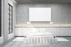 Master bedroom with a double bed, a poster and two lamps Royalty Free Stock Images