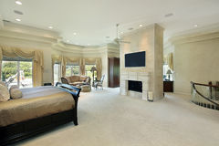 Master bedroom with fireplace stock images