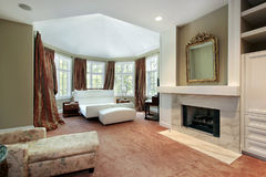Master bedroom with fireplace Stock Photos