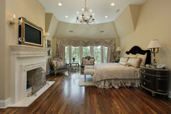 Master bedroom with fireplace Stock Photography