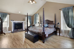 Master bedroom with fireplace Royalty Free Stock Photography